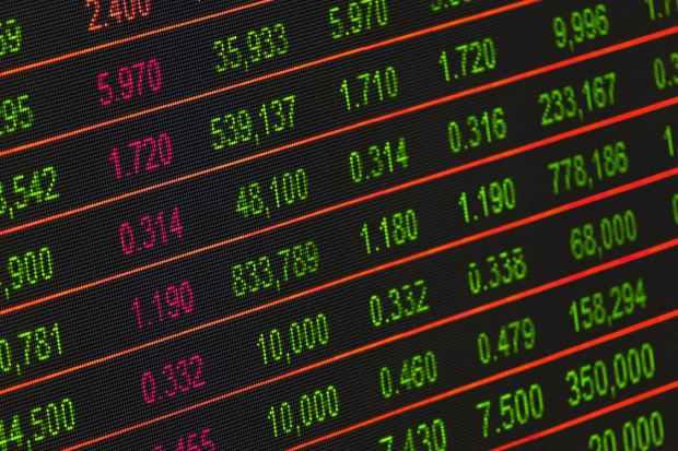 pexels-photo-210607-stock exchange ticker